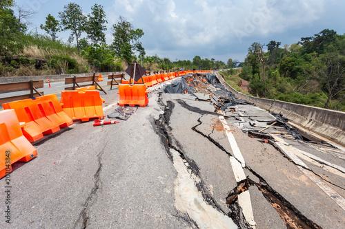 Big damage of asphalt road on the hillside cause of heavy rain and sliding earth Fototapete