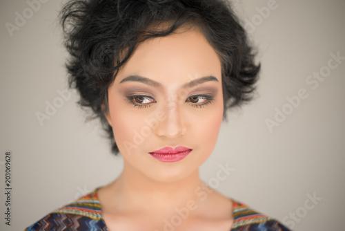 Young woman envy on  white background Fototapeta