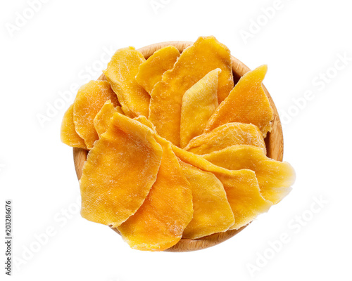 Dehydrated mango slices in a wooden bowl isolated on white. Dried fruits. Natural healthy candy.