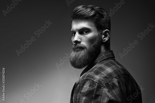 Black and white photo of bearded stylish businessman Handsome confident perfect hairstyle man indoor Fototapet