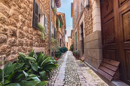 Fototapeta Silent cobbled narrow street in Fornalutx village, Majorca Balearic Islands