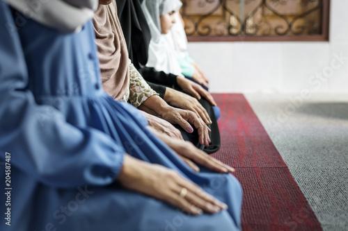 Muslim women meditating in the mosque during Ramadan
