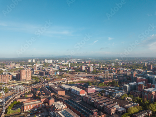 Obraz na plátne Manchester City Centre Drone Aerial View Above Building Work Skyline Construction Blue Sky Summer Beetham Tower Deansgate