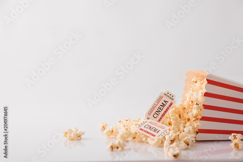 Drink popcorn and movie tickets on white background front detail