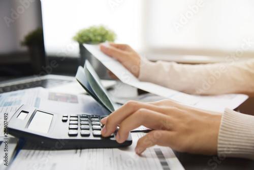 Woman calculating her Debt. Fototapet