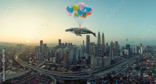Obraz na plátně Whale floats in the air above the clouds with bunch of colorful balloons