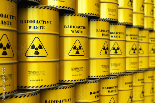 Fotografia Group of stacked yellow drums with radioactive waste