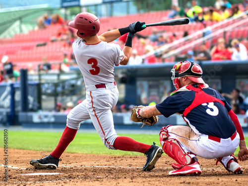 Canvas Print baseball player hitting and sliding
