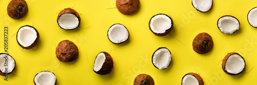 Fotografie, Tablou Pattern with ripe coconuts on yellow background