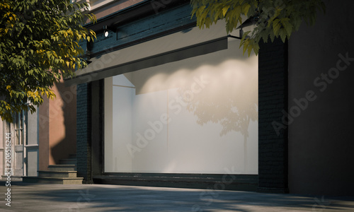 Fotografia Blank shop window in the night street with light on the frame