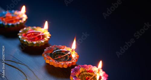 Diya lamps lit during celebration