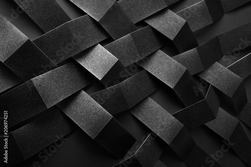 Abstract pattern made of black paper, dark background