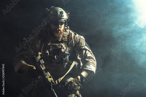 Fotografie, Obraz Special forces soldier with rifle on dark background