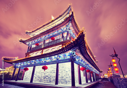 Xian city wall ancient building at night, color toned picture, China.
