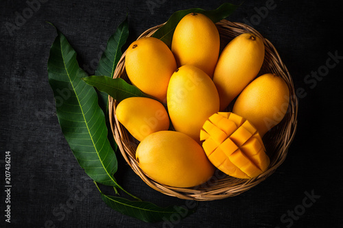 Yellow Mango Beautiful skin In the basket Blackboard background