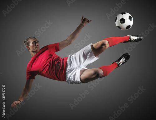 Obraz na płótnie Soccer player in action on black background.