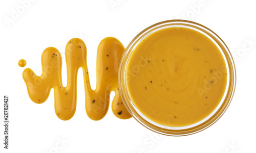 Obraz na płótnie Mustard sauce in bowl isolated on white background. Top view