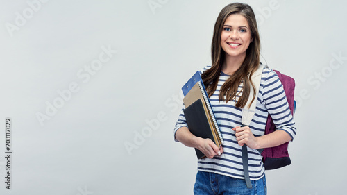 Photo Student woman with backpack holding book and notebooks.