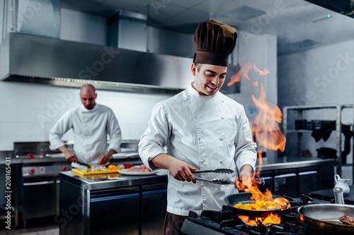 Fotografiet Creating a delicious dish
