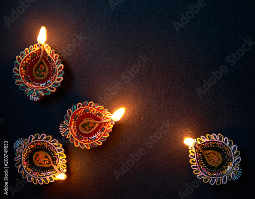 Happy Diwali - Colorful Diya lamp on floor