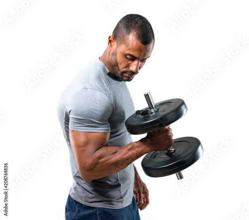 Strong handsome sport man making weightlifting and exercising the biceps on isolated white background