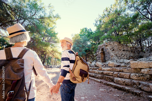 Travel and tourism. Senior family couple walking together on ancient sighseeing.