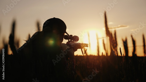 Fotografie, Obraz A sniper rifles from a rifle with an optical sight
