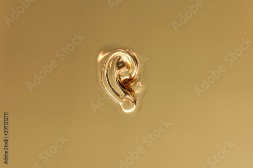 Stampa su Tela An ear as a background in gold look - 3D Rendering