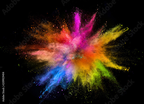 Photo Colored powder explosion isolated on black background.