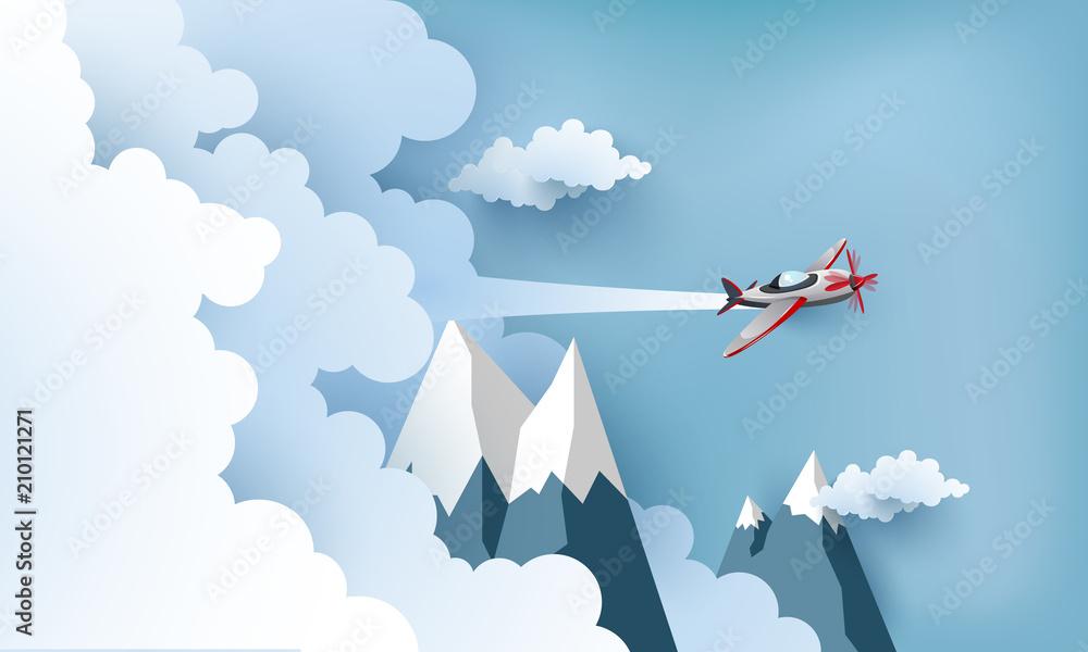 Fototapeta Samolot lecący nad chmurami i górami