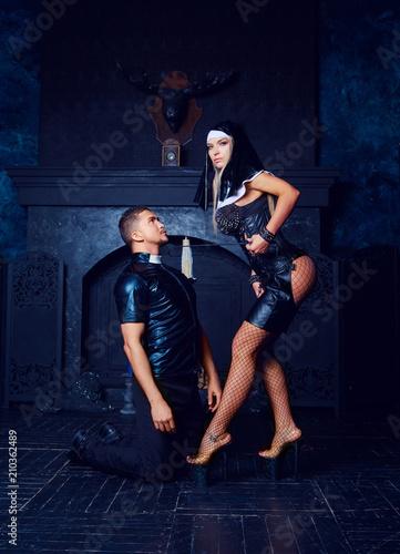 Obraz na plátne striptease dancers dressed as a nun and priest