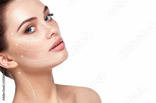 Fotografiet portrait of beautiful woman with perfect skin of the face, with arrows on face, concept of lifting skin