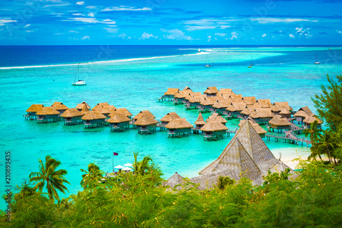 Obraz na plátně Aerial view of overwater bungalow luxury resort in turquoise lagoon water of Moorea, French Polynesia
