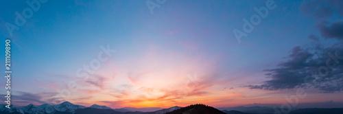 Valokuvatapetti Sunset sky above mountains