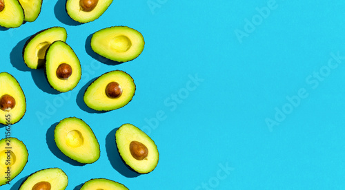 Obraz na plátne Fresh avocado pattern on a blue background flat lay