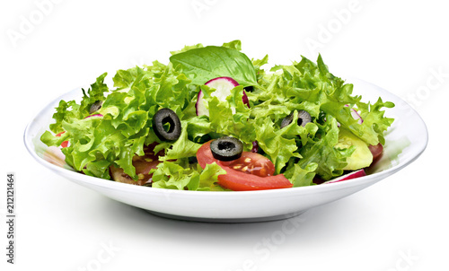 Delicious fresh salad dish on a white plate, isolated on white background. Healthy eating scene, fresh lettuce, tomatoes, cucumber and olives in a bowl.