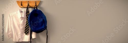 Photo School uniform and schoolbag hanging on hook
