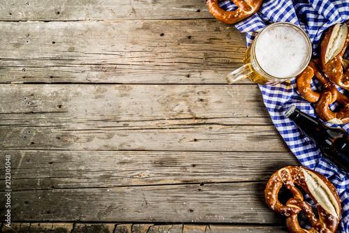 Fotografija Oktoberfest food menu, bavarian pretzels with beer bottle mug on old rustic wood