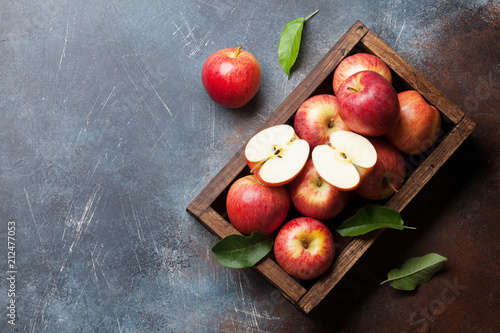 Red apples in wooden box