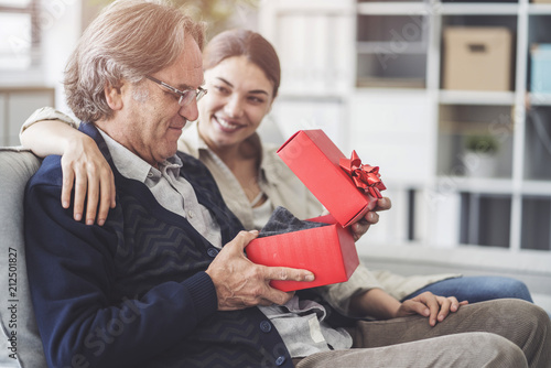 Young daughter gives her father a gift