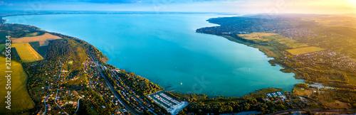 Fotografie, Obraz Balatonfuzfo, Hungary - Panoramic aerial skyline view of the Fuzfoi-obol of Lake Balaton at sunset