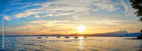 Stampa su Tela Spectacular sunset with beautiful light at City of Bardolino / Lake Garda in Ita