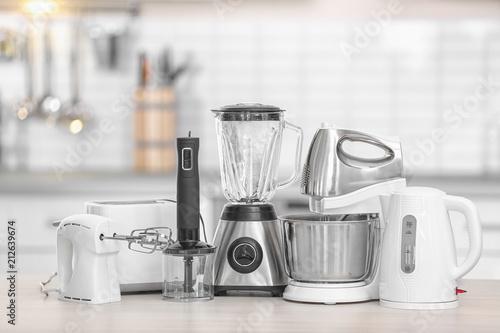 Different modern kitchen appliances on table indoors. Interior element