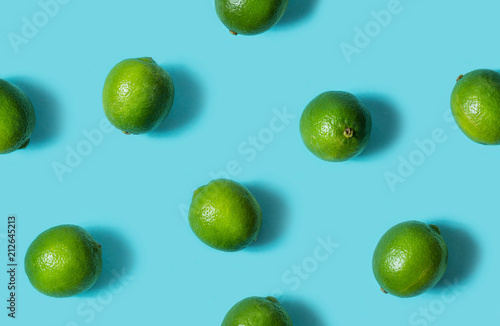 Top view of fresh lime isolated on blue background