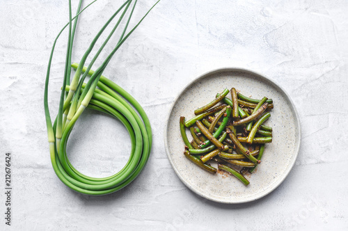 Grilled garlic scapes salad. Traditional Korean Chive Salad (Buchu Muchim). Top view.