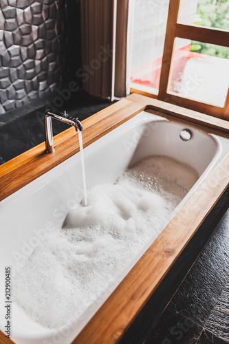 Fotografija Water filling bath with foam