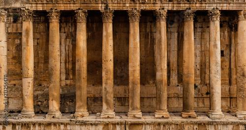 Fényképezés Frontal view of a colonnade - Row of columns of an ancient Roman temple ruin (Ba