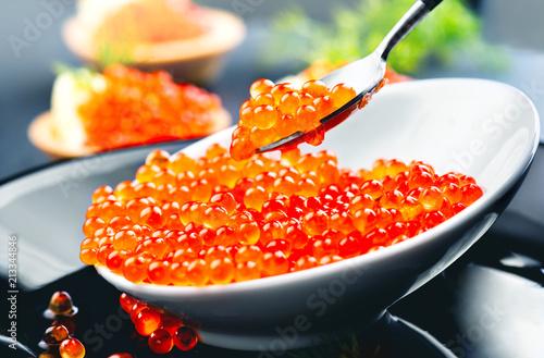 Caviar. Salmon caviar in a bowl. Closeup trout caviar. Gourmet food. Seafood