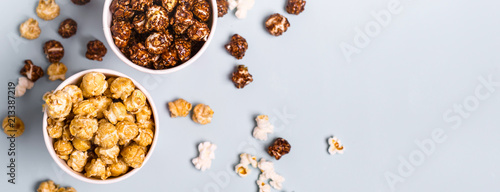 Sweet and salted popcorn on a blue background