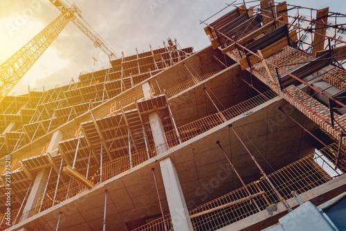 Vászonkép Building construction site with scaffolding